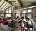 Muztagh Chalet Courchevel 1850 wood red and gray interior